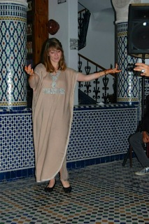 Dancing with Henna-d hands in Fez, Morocco.